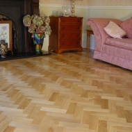 Prime Oak block in herringbone pattern with a two block border. Finished with Hardwax Oil. Newport, South Wales