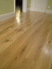 Engineered board 15mm with 4mm surface of Character Oak. Finished on site with Hardwax Oil. Laid over 'SilentLay' mattin - Photo 2 of 17