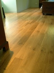 Engineered board 15mm with 4mm surface of Character Oak. Finished on site with Hardwax Oil. Laid over 'SilentLay' mattin - Photo 12 of 17