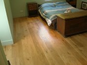 Engineered board 15mm with 4mm surface of Character Oak. Finished on site with Hardwax Oil. Laid over 'SilentLay' mattin - Photo 13 of 17