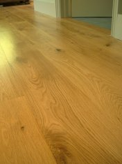 Engineered board 15mm with 4mm surface of Character Oak. Finished on site with Hardwax Oil. Laid over 'SilentLay' mattin - Photo 14 of 17