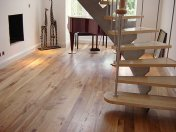 English Elm, 75mm, 100mm & 125mm over underfloor heating finished with hardwax oil. Staircase by Bob Coles - Photo 2 of 10