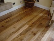 English Elm, 75mm, 100mm & 125mm over underfloor heating finished with hardwax oil. Staircase by Bob Coles - Photo 8 of 10