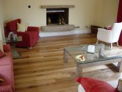 English Elm, 75mm, 100mm & 125mm over underfloor heating finished with hardwax oil. Staircase by Bob Coles - Photo 9 of 10