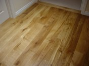Enginnered board, bonded to concrete in a new house and finished on site like a real wood floor. - Photo 4 of 9