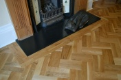 Oak block floor laid in a double herringbone pattern with a two block border and finished with Hardwax Oil - Photo 5 of 20