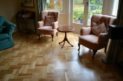 Oak block floor laid in a double herringbone pattern with a two block border and finished with Hardwax Oil - Photo 8 of 20