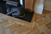 Oak block floor laid in a double herringbone pattern with a two block border and finished with Hardwax Oil - Photo 9 of 20