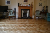 Oak block floor laid in a double herringbone pattern with a two block border and finished with Hardwax Oil - Photo 11 of 20