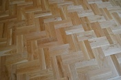 Oak block floor laid in a double herringbone pattern with a two block border and finished with Hardwax Oil - Photo 12 of 20