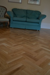 Oak block floor laid in a double herringbone pattern with a two block border and finished with Hardwax Oil - Photo 13 of 20