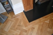 Oak block floor laid in a double herringbone pattern with a two block border and finished with Hardwax Oil - Photo 14 of 20