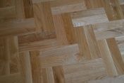 Oak block floor laid in a double herringbone pattern with a two block border and finished with Hardwax Oil - Photo 15 of 20