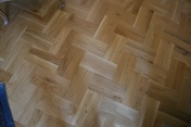 Oak block floor laid in a double herringbone pattern with a two block border and finished with Hardwax Oil - Photo 20 of 20
