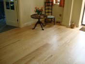 Ash plank with traffic lacquer. Pictures taken following a refurbishment twelve years after installation. - Photo 2 of 19