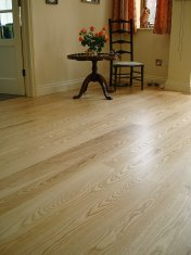 Ash plank with traffic lacquer. Pictures taken following a refurbishment twelve years after installation. - Photo 7 of 19