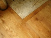 Solid English Character Oak over Underfloor Heating. Mild Antique stain and Hardwax Oil finish. Pictures taken one year - Photo 16 of 18