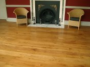 Solid English Character Oak over Underfloor Heating. Mild Antique stain and Hardwax Oil finish. Pictures taken one year - Photo 2 of 18