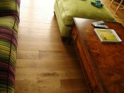 Solid English Character Oak over Underfloor Heating. Mild Antique stain and Hardwax Oil finish. Pictures taken one year - Photo 4 of 18
