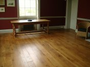 Solid English Character Oak over Underfloor Heating. Mild Antique stain and Hardwax Oil finish. Pictures taken one year - Photo 5 of 18