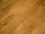 Solid English Character Oak over Underfloor Heating. Mild Antique stain and Hardwax Oil finish. Pictures taken one year - Photo 6 of 18