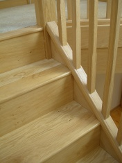 Good quality engineered Oak flooring with staircase clad in Oak to match - Photo 7 of 17