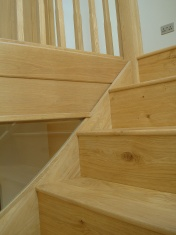 Good quality engineered Oak flooring with staircase clad in Oak to match - Photo 8 of 17