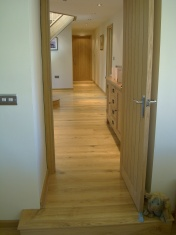 Good quality engineered Oak flooring with staircase clad in Oak to match - Photo 11 of 17