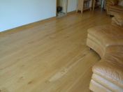 Good quality engineered Oak flooring with staircase clad in Oak to match - Photo 13 of 17