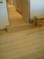 Good quality engineered Oak flooring with staircase clad in Oak to match - Photo 14 of 17