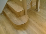 Good quality engineered Oak flooring with staircase clad in Oak to match - Photo 16 of 17