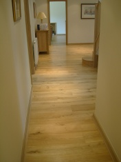 Good quality engineered Oak flooring with staircase clad in Oak to match - Photo 17 of 17