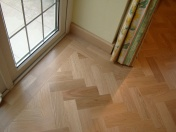 American Oak block in a herringbone pattern finished with Bona Traffic lacquer. Skirting board to match. - Photo 2 of 15