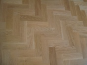 American Oak block in a herringbone pattern finished with Bona Traffic lacquer. Skirting board to match. - Photo 11 of 15