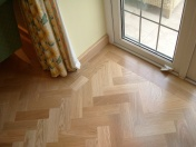 American Oak block in a herringbone pattern finished with Bona Traffic lacquer. Skirting board to match. - Photo 13 of 15