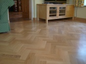 American Oak block in a herringbone pattern finished with Bona Traffic lacquer. Skirting board to match. - Photo 14 of 15