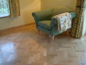 American Oak block in a herringbone pattern finished with Bona Traffic lacquer. Skirting board to match. - Photo 3 of 15