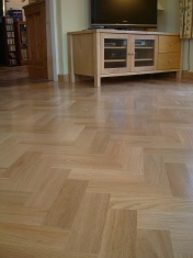 American Oak block in a herringbone pattern finished with Bona Traffic lacquer. Skirting board to match. - Photo 4 of 15