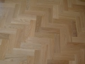 American Oak block in a herringbone pattern finished with Bona Traffic lacquer. Skirting board to match. - Photo 5 of 15