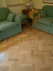 American Oak block in a herringbone pattern finished with Bona Traffic lacquer. Skirting board to match. - Photo 7 of 15