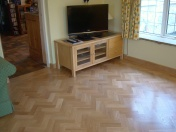American Oak block in a herringbone pattern finished with Bona Traffic lacquer. Skirting board to match. - Photo 8 of 15