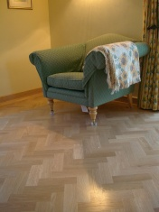 American Oak block in a herringbone pattern finished with Bona Traffic lacquer. Skirting board to match. - Photo 9 of 15