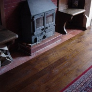 Solid English Character Oak with a dark Van Dyke stain and finished with Hardwax Oil