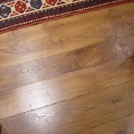 English Character Oak, hand distressed, antique stained. Fitted over underfloor heating.
