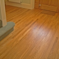 Narrow Oak. Replacement for water damaged floor in a hallway. Insulation inserted as part of works