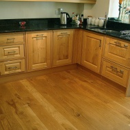 English Character Oak in a kitchen. Pictures taken five years after laying.