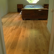 Engineered board 15mm with 4mm surface of Character Oak. Finished on site with Hardwax Oil. Laid over 'SilentLay' mattin