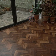 Character Walnut block floor in herringbone pattern. Finished with Hardwax Oil. Photos taken during refurbishment after