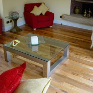 English Elm, 75mm, 100mm & 125mm over underfloor heating finished with hardwax oil. Staircase by Bob Coles