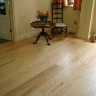 Ash plank with traffic lacquer. Pictures taken following a refurbishment twelve years after installation.
